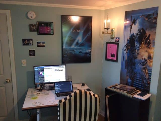 A Cornershop Creative employee's office setup. Desk, computer, striped chair.