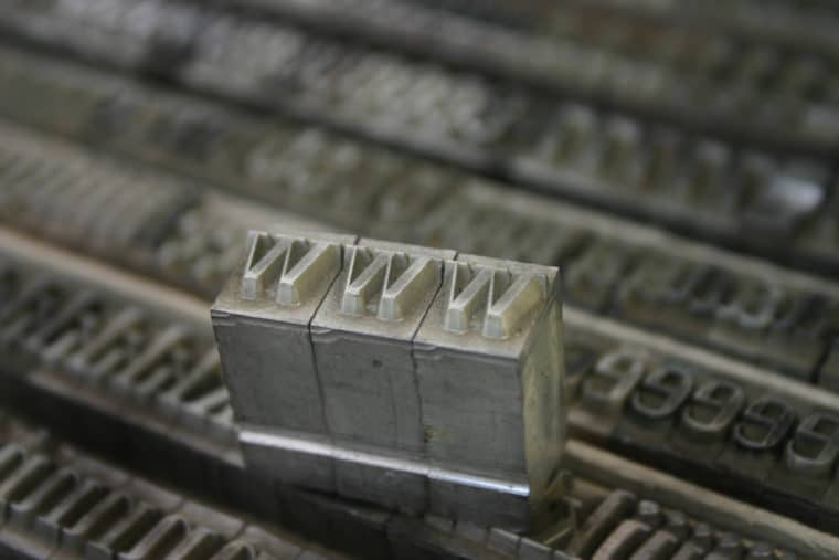 """Image of movable type from a printing press spelling out """"www"""""""